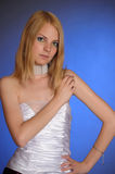 Blonde in an elegant white evening gown Stock Photos