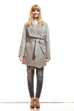 Blonde elegant woman in gray coat. Royalty Free Stock Photography