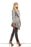 Blonde elegant woman in gray coat. Royalty Free Stock Photo