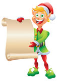 Blonde elf holding christmas wishlist isolated Stock Photo