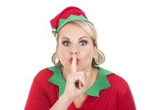 Blonde Elfenfrau, die ruhiges Zeichen zeigt Stockfoto