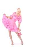 Blonde em um vestido cor-de-rosa imagens de stock royalty free