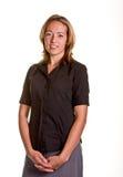 Blonde en manos negras de la camisa en frente Fotografía de archivo libre de regalías