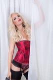 Blonde en ropa interior roja Foto de archivo