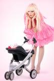 Blonde en una alineada rosada Fotografía de archivo libre de regalías