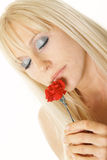 Blonde enjoying flower Royalty Free Stock Images