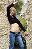 Blonde et monument Photos stock