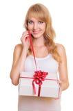 Blonde et un cadre de cadeau Photo stock