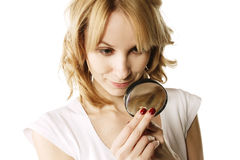 Blonde examining ring Stock Photo
