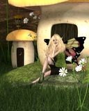 Blonde Fairy and Toadstool House Stock Photo