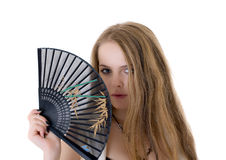 Blonde with a fan Royalty Free Stock Image
