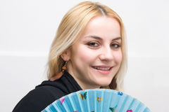 Blonde with fan Royalty Free Stock Photography