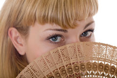Blonde with a fan Royalty Free Stock Photo