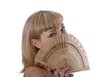 Blonde with a fan Royalty Free Stock Photos