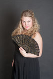 Blonde with a fan Royalty Free Stock Photography