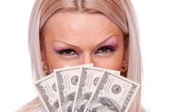 Blonde with a fan of Dollar bills Royalty Free Stock Photo