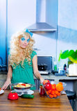Blonde fashion funny on kitchen with pasta and Stock Photo