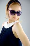 Blonde Fashion girl 60s eyewear. Fashion model 60s style serious with sun glasses stock photos