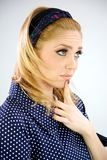 Blonde Fashion girl 60s thinking. Very concentrated Stock Photos