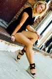 Blonde Fashion Model. Sexy blonde fashion model in casual black clothing Royalty Free Stock Photos