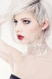 Blonde fashion model in plastic Royalty Free Stock Photo
