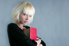 Blonde fashion student holding red book. Gesture royalty free stock image