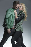 Blonde fashion woman pulling her boyfriend by the collar Royalty Free Stock Photo