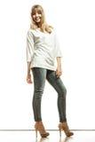 Blonde fashion woman in white shirt denim pants Stock Images