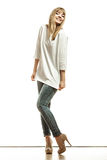 Blonde fashion woman in white shirt denim pants Stock Photography