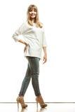 Blonde fashion woman in white shirt denim pants Royalty Free Stock Photos