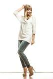 Blonde fashion woman in white shirt denim pants Stock Photo