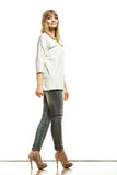 Blonde fashion woman in white shirt denim pants Royalty Free Stock Images