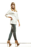 Blonde fashion woman in white shirt denim pants Royalty Free Stock Photography