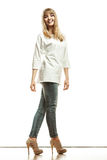 Blonde fashion woman in white shirt denim pants Stock Photos