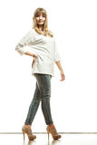 Blonde fashion woman in white shirt denim pants Royalty Free Stock Photo