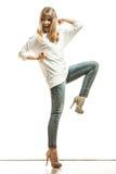Blonde fashion woman in white shirt denim pants Royalty Free Stock Photography