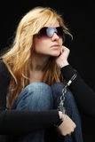 Blonde fashionable girl with handcuffs Royalty Free Stock Image