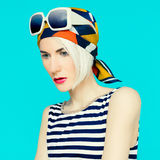 Blonde in fashionable summer accessory. Royalty Free Stock Images