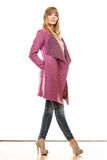 Blonde fashionable woman in vivid color coat. Stock Photos