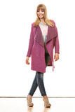 Blonde fashionable woman in vivid color coat. Stock Photography