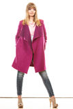 Blonde fashionable woman in vivid color coat. Royalty Free Stock Photos