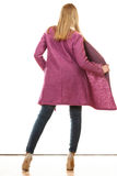 Blonde fashionable woman in vivid color coat. Royalty Free Stock Images