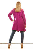 Blonde fashionable woman in vivid color coat. Stock Photo