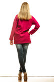 Blonde fashionable woman in vivid color coat. Royalty Free Stock Photography