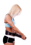 Blonde fastening her belt. Picture of young sportswoman with fitness belt stock photo