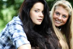 Blonde feat. brunette Royalty Free Stock Images