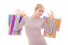 Blonde feliz con los bolsos de compras Fotos de archivo