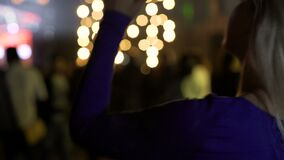Blonde female dancing with her hands up at concert, relaxation, active nightlife. Stock footage stock video footage