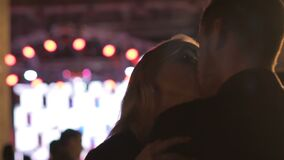 Blonde female dancing and kissing young man at night club party, vulgar behavior. Stock footage stock video footage