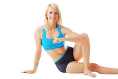 Blonde female fitness trainer looking straight to the camera Royalty Free Stock Images
